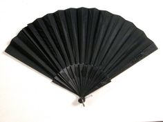 1859 Mourning Fan, Natalie (London), made of satin, wood, and metal.