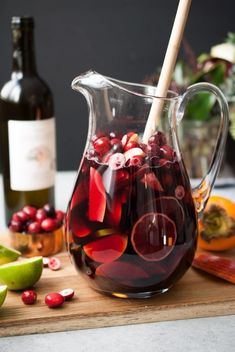 11 Red Food Color Recipes to Try Now: cranberry apple persimmon sangria Holiday Sangria, Apple Sangria, Festive Cocktails, Holiday Drinks, Summer Drinks, Cocktail Drinks, Cocktail Recipes, Drink Recipes, Moscato Sangria