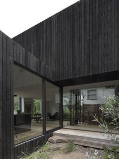 House A by Walter & Walter Ensuring an Optimum Indoor-Outdoor Connection - - The house sits in an open landscape and ensuring an optimum indoor-outdoor connection. A simple facade and massing focuses attention. Modern Architecture House, Modern House Design, Interior Architecture, Interior Design, Timber Cladding, Exterior Cladding, Eco Friendly House, White Houses, Black House