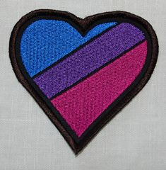 Embroidered Bisexual Pride flag patch now in a heart shape- measures 8cm across the top of the heart (3.5).  Sew or pin onto clothes or a bag