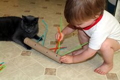 Fine motor practice with straws and paper towel roll
