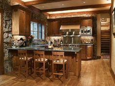 Awesome-Kitchens-Remodeling-and-Makeovers-Layouts-rustic-atmosphere-in-with-stone-wall-and-wood-back-stools-also-decorative-flower-on-grey-marble-cabinets.jpg (1024×768)