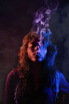 Smoking - It was a two light setup experiment with color gels with my friend. To create some drama i added some smoke with my model