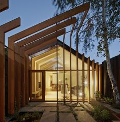 """Cross Stitch House by FMD Architects. FMD Architects used slender lengths of timber to """"stitch"""" together this narrow Melbourne house and its new garden extension. Architecture Courtyard, Architecture Design, Timber Architecture, Residential Architecture, Timber Buildings, Landscape Architecture, House Landscape, Amazing Architecture, Natural Architecture"""