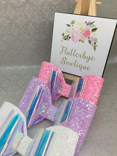 A luxurious looking bow created from your colour choice of glitter paired with a translucent and iridescent material that changes colour as it hits the light. It is a truly impressive bow that measures approximately 4 inches and will be loved by any little girl.