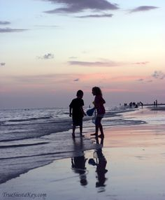 Children Playing on Siesta Key (Photo) The gorgeous sunsets on Siesta Beachare just one of the reasons we love helping buyers and investors purchase beach condos, waterfront homes, and luxury real estate on Siesta Key, one of Sarasota, Florida's beautiful barrier islands.