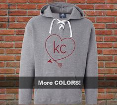 You will fall in love with this heavyweight KC heart lace-up hoodie. Its heavy, soft and perfect for those chilly KC Royals, KC Chiefs and Sporting KC games! Choose from 3 sweatshirt colors and over 20 design colors including glitter! #KC #KCROYALS #KCCHIEFS