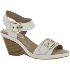 Jinny is a double banded wedge sandal, with an adjustable buckle for a more personalized fit. Features a padded sock and a stack look detail on the wedge.