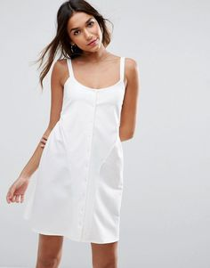 Buy it now. ASOS Mini Smock Babydoll Dress with Button Detail - Cream. Dress by ASOS Collection, Smooth stretch fabric, Scoop neckline, Button placket, Smock style, Loose fit � falls loosely over the body, Machine wash, 97% Polyester, 3% Elastane, Our model wears a UK 8/EU 36/US 4 and is 176 cm/5'9.5� tall. ABOUT ASOS COLLECTION Score a wardrobe win no matter the dress code with our ASOS Collection own-label collection. From polished prom to the after party, our London-based design team s...