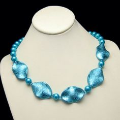 Vintage Faux Pearls Necklace Aqua Blue Glass Iridescent Discs Unique Design from #MyClassicJewelry on Etsy: http://ift.tt/1hyCtgg