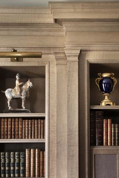John B. Murray Architect   library - gorgeous millwork - anigre wood finished with a gray stain.