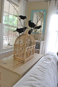 I don't decorate much for Halloween, only really for Fall.  But, I would do this.  Then, take the blackbirds out and it's a cage that is perfect to decorate with every day.