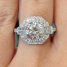 1.50ct round brilliant in a custom vintage style setting with round and asscher cut diamonds