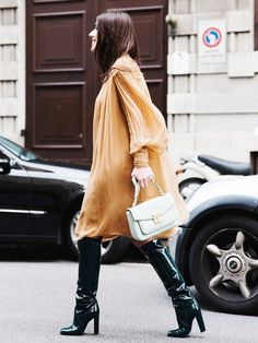Parisienne: Pair a little dress with tall boots