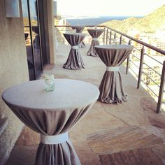Linen cocktail tables tie perfectly with Villa Bellissima architecture at this Wedding last week end in Cabo!
