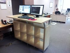 I wanted a standing desk for work, so I cobbled together a bunch of IKEA pieces to make this. Pretty happy with it so far! If you want to make one of your own, here's the recipe I used: http://wiki.colar.net/ikea_standing_desk