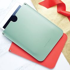 personalised leather sleeve for ipad by brit-stitch   - they do a burnt orange colour.