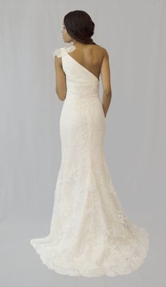 2250 by Tara Keely size 14 RRP £2000, now £1000 A-symmetric neckline, ivory corded lace