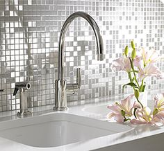 Allow brushed stainless steel mosaic tile.  From annsacks.com