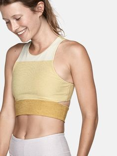 Midweight crop top with colorblocked panels, high neck, and slash cut out. Go ahead, talk back.