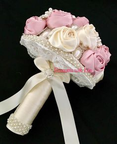 Pinks/ivory and bling. Detailing finish to the underside which you always receive from Bouquets with love