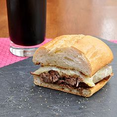 Stout French Dip with Grilled Onions and Horseradish with a side of Au Jus.