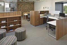 These open plan workstations feature Epic casegoods and storage with Mix-It seating. Whimsy impromptu seating adds additional pull up seating, when needed. #NationalOffice #NationalHQ #FurnitureWithPersonality
