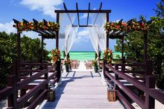 """A recent addition to The Ritz-Carlton, Aruba is the boardwalk leading to Palm Beach. This is quickly becoming a favorite spot for couples to say """"I do"""" and to take both formal and informal portraits on their wedding day."""