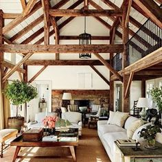 Reclaimed timber beams accent the barnlike common room at Lynn and Sir Evelyn de Rothschild's Martha's Vineyard home, which was built by Rivkin/Weisman Architects and decorated by Mark Cunningham. Perfect example of too much going on. Architectural Digest, Sweet Home, House In The Woods, My Dream Home, Dream Homes, Home Fashion, Home And Living, Living Rooms, Cozy Living