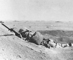 Uncommon valor in a peaceful setting: this 4th Division Marine threatens theenemy even in death. His bayonet fixed and pointing in the direction of theenemy, he was killed by a sniper before he even got off the beach on D-day.