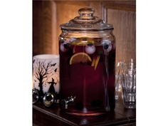 Skeleton Sangria  2 bottles chilled dry red wine (zinfandel, merlot or pinot noir)   2 oranges, thinly sliced   8 ounces pineapple nectar  8 ounces sparkling water  8 ounces Cointreau  4 cups ice cubes  2 ounces fresh lime juice