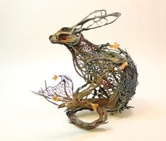 Surrealist sculpture 'The Curiosity of Laurices III' by Ellen Jewett.  Features a rabbit with aquatic and medieval references, a curious nod to the origin of rabbit domestication https://www.etsy.com/shop/creaturesfromel