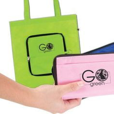 """- Folding Durable Eco Friendly 80 GSM Polypropylene tote bag. - Includes metal keychain ring attached to zipper - Front open pocket. - 22"""" handles. - Easily folds up and zippers into a slim 7.5"""" x 4"""" pouch (all one piece).  - Bag ships folded."""