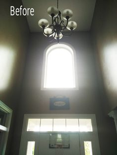 Before Painting Two Story Entry Great Room Paint Colors, Entryway Paint Colors, Front Door Entryway, Entryway Decor, Window Above Door, Entryway Light Fixtures, Big Chandelier, Front Doors With Windows, Entry Lighting