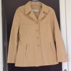 Leather coat Fully lined beige leather coat from Andrew Marc. In great condition. Minor scratches and discoloration in about 3-4 places on the back and shoulder. Will fit a medium or large. (G1) Jackets & Coats