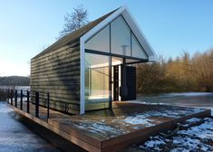 Rotterdam studio 2by4-architects designed this gabled summer house so the walls of one corner fold open.