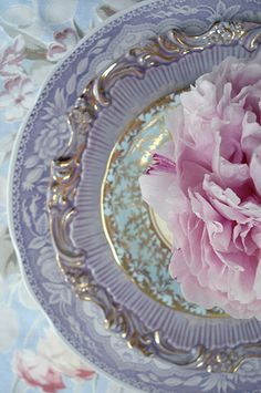 .This is how I always set my table even for everyday- a charge plate, a salad plate and a dinner plate with a beautiful tablescapes to match