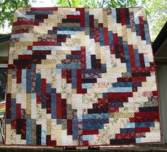 Jelly rolls made into a Log Cabin Quilt?  Nice blog but didn't see this quilt on it!  Good for reference or ideas.  ~Kelly