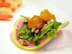 Lane Southern Orchards' peaches flambéed with bourbon, organic watermelon radish, BJ's Hydroponics watercress salad with house-made lemon vinaigrette, Belle chevre montrachet-style goat cheese and Georgia pecans.    Affairs to Remember Caterers  www.affairs.com