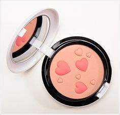 MAC Archie's Girls Flatter Me Pearlmatte Face Powder. Photo from www.temptalia.com