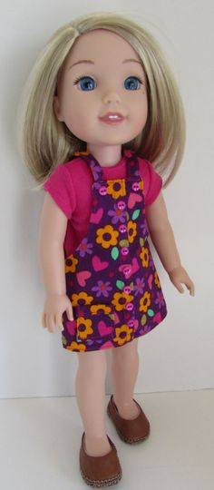 Purple flowered jumper by JenAshleyDollDesigns on Etsy. Made using the Faux Button Jumper for WellieWishers Dolls pattern. Find it here http://www.pixiefaire.com/products/faux-button-jumper-for-welliewishers-dolls. #pixiefaire #fauxbuttonjumperforwelliewishersdolls