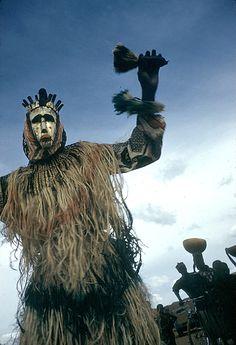 Dyoboli dancer wearing metal-covered masks, Cercle of San, Mali. Eliot Elisofon