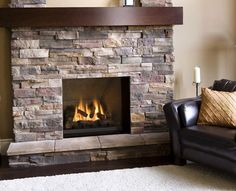 gas fireplace stone veneer ideas airstone wooden mantel leather armchair