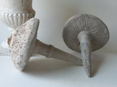 two cement mushrooms by unpotpourri on Etsy, $44.00