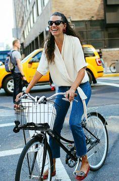 Stylist Stella Greenspan rides her bike through Manhattan during New York Fashion Week.Photo by Phil Oh