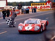 below, posing at the 24 Hours of Le Mans, in Le Mans, France in 1967 ...