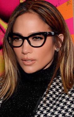 Jennifer Lopez made glasses a red carpet worthy accessory in NYC on October 19 when she wore her cat frame glasses with contoured skin a nude lip and neutral eye makeup. Get expert tips for wearing makeup with glasses like Jennifer Lopez. Fashion Eye Glasses, Cat Eye Glasses, Makeup With Glasses, Maquillage Jlo, How To Wear Makeup, Lunette Style, Blonde Makeup, Cool Glasses, Glasses Frames