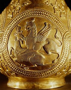 Griffin killing a hind - gold pitcher of Nagyszentmiklos  The treasure of Nagyszentmiklos. The gold treasure found in 1799 in Nagyszentmiklos (now Sinicolaul in Romania) consists of 23 pure gold vessels. The medallion on this gold pitcher shows a griffin killing a hind.