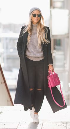 Wear the long coat trend with distressed denim and knitwear to steal Janni Deler's awesome style. Rocking sneakers and a cute grey beanie, Janni has epitomised the cute winter aesthetic! Coat/Jeans: Gina Tricot, Sweater: Niy Trend by Janni, Bag: Phillip Lim, Shoes: Senso.