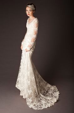 probably the only long sleeve wedding gown I would ever consider wearing. love all the sheer lace!!!